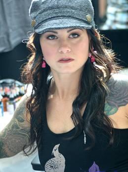 Kim Saigh Tattoos